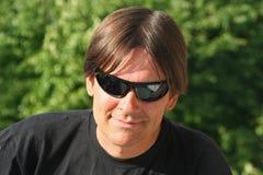 острословие солнечных очков человека стоковое фото rf