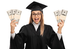 Осчастливленный аспирант держа пачки денег Стоковые Изображения RF