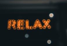 Ослабьте, афиша неонового света Стоковое Фото