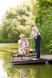 Ослаблять на береге озера Стоковые Фото