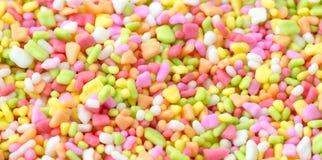 Отбензинивание крупного плана красочное сладостное для предпосылки хлебопекарни стоковое фото rf