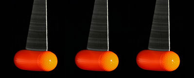 3 отбрасывая шара для игры в гольф покрашенных апельсином Стоковая Фотография RF