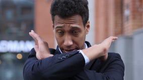 Отвергающ, невзлюбить жест африканским бизнесменом