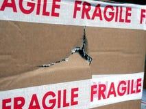 Отверстие в картонной коробке Стоковое Фото