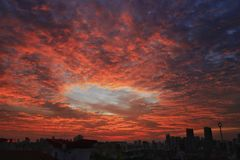 Отверстие в красном небе Стоковое фото RF