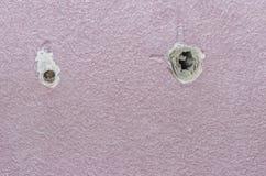 Отверстие сверла на розовой стене Стоковая Фотография