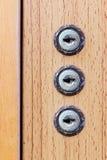 Отверстие для ключа на деревянной предпосылке Стоковая Фотография RF