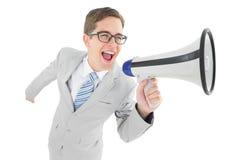 Отвратительный бизнесмен крича через мегафон Стоковая Фотография