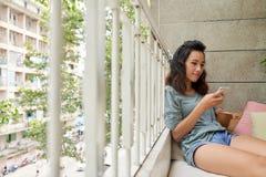 Отдыхать на балконе Стоковая Фотография RF