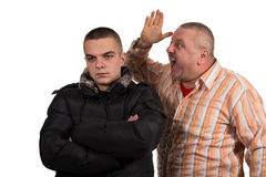 Отец и сынок имея аргумент Стоковая Фотография