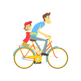 Отец и сын на велосипеде Стоковое Изображение