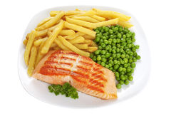 откалывает горохи еды покрыл salmon стейк стоковое фото