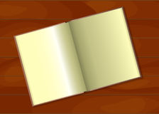Открытая книга на таблице Стоковые Изображения RF