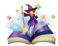 Открытая книга с изображением ведьмы держа веник Стоковая Фотография RF