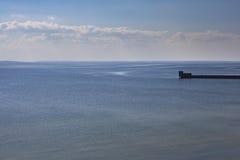 Открытка от гавани, моря во время захода солнца Стоковое Изображение RF
