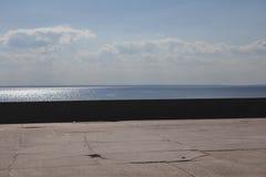Открытка от гавани, моря во время захода солнца Стоковое Изображение