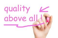 Отметка качества прежде всего розовая Стоковое фото RF