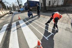 Отмечать работа на расположении пешеходного перехода Стоковое фото RF