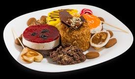 Отображайте много очень вкусных тортов стоковые изображения