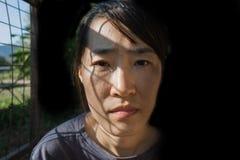 Отожмите женщину в клетке с светом Стоковое фото RF
