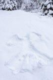 Отпечаток на снеге в форме ангела Стоковые Изображения RF