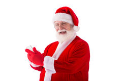 Отправляя СМС Санта Клаус Стоковое Изображение RF