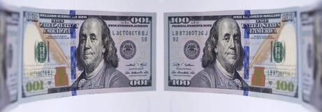 Отражающ банкноту 100 долларов Стоковое Изображение RF