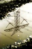Отражение башни передачи в лужице Стоковое Фото