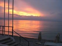 Отражение захода солнца в воде стоковая фотография