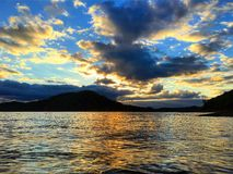 Отражение захода солнца Стоковые Фото