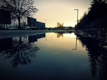 Отражение захода солнца Стоковые Изображения RF