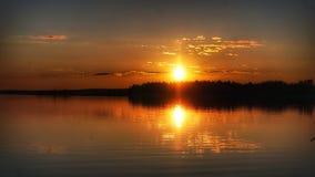 Отражение захода солнца Стоковое Изображение
