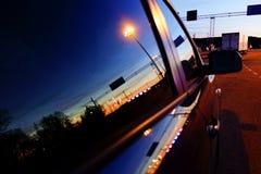 Отражение заходящего солнца в гавани Турку в окне автомобиля Стоковое Изображение
