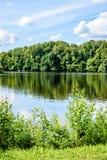 Отражение облаков в озере Стоковое фото RF