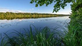 Отражение облаков в озере Стоковая Фотография