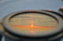 Отраженный заход солнца в компасе Стоковая Фотография