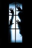 Отраженный силуэт людей Стоковое Изображение