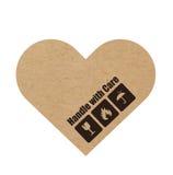 Отрегулируйте с осторожностью символы на сердце бумаги или картона ремесла Стоковые Фотографии RF