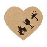 Отрегулируйте с осторожностью символы на сердце бумаги или картона ремесла Стоковые Фото