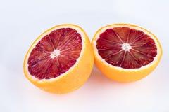 Отрежьте апельсин крови на белизне Стоковая Фотография RF