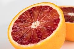 Отрежьте апельсин крови на белой предпосылке Стоковое фото RF