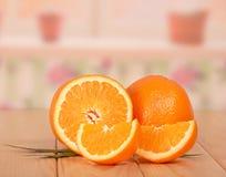 Отрежьте апельсин на белизне Стоковые Фотографии RF