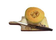 отрежьте свежее половинное органическое rockmelon Стоковое Изображение RF