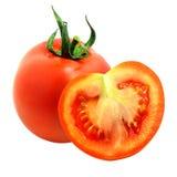 отрежьте свежий изолированный томат Стоковые Изображения RF