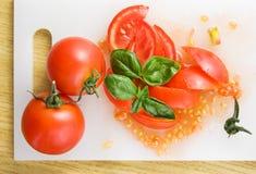 отрежьте томаты Стоковые Изображения RF
