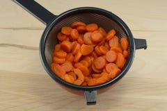 Отрезанные законсервированные моркови стоковое изображение