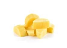 Отрезанные картошки на белой предпосылке Стоковые Фото