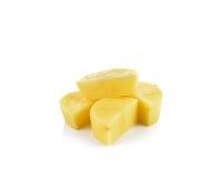 Отрезанные картошки на белой предпосылке Стоковое Фото