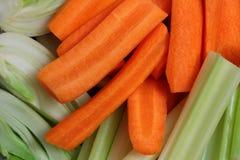 Отрезанные моркови и огурцы стоковые фотографии rf