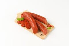 Отрезанные сосиски pepperoni стоковое изображение